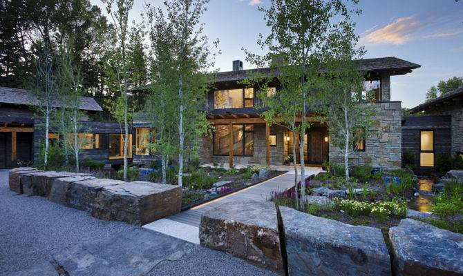 Contemporary Stone Farmhouse Aged Wood Siding