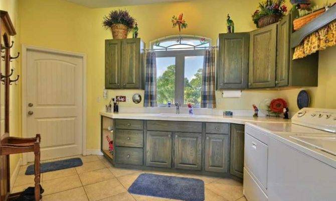 Country Laundry Room Specialty Door Travertine Tile Floors