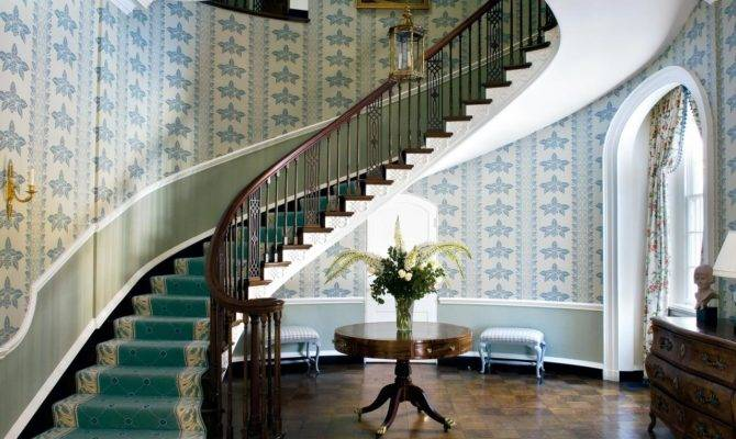 Elegant Foyer Sweeping Staircase Dramatic Focuses
