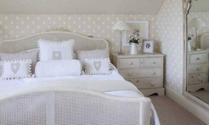 Elegant Slanted Ceiling French Country Bedroom