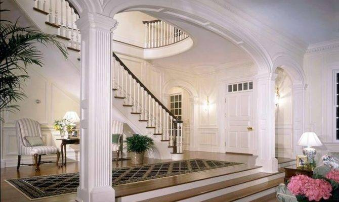 Foyer White Arched Square Pillars Beautifully Trimmed