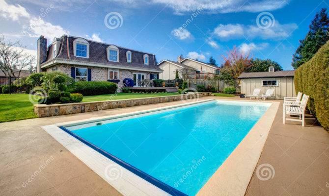 Large Backyard Flowerbed Swimming Pool