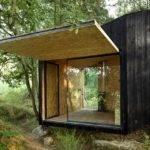 Modern Forest Retreat Uses Boulder Foundation