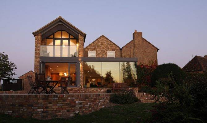 Modern Glass Addition Otherwise Traditional Home