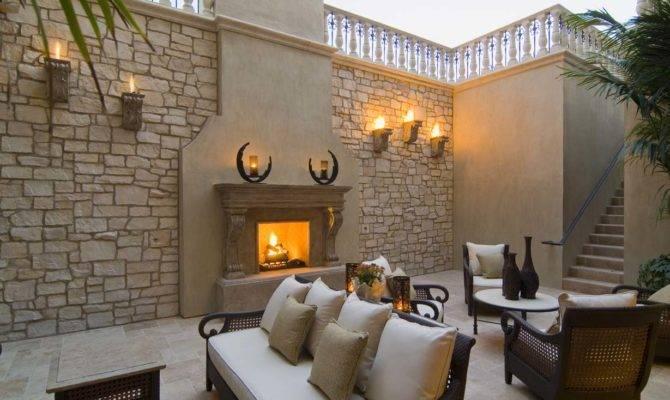 Outdoor Fireplace Trend Heats Realm Design Inc