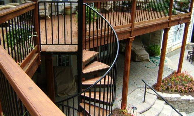 Second Story Wood Deck Spiral Staircase Stone Patio Garden