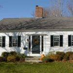 Small Cape Cod Home Center Chimney Traditional Homes