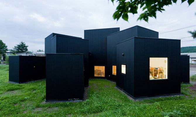 Small House Big Impact Black Facade White Interiors