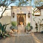 Spanish Colonial Courtyard Features Cantera Stone Gate