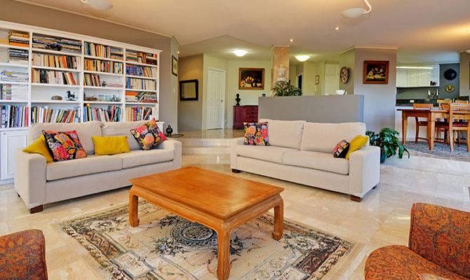 Split Level Living Room Using Grey Colours Carpet