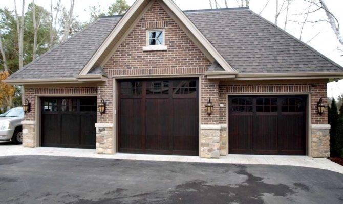 Three Dark Brown Coloring Garage Doors Brick Wall
